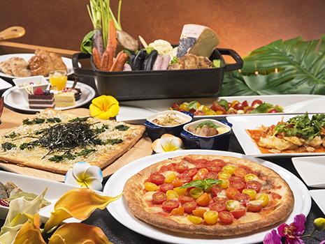 地元食材をふんだんに使用したグリル料理や窯焼きピザなどの料理とともに